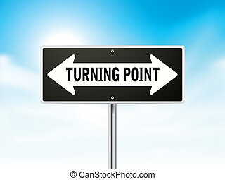 turning point on black road sign