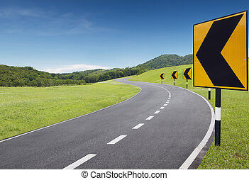 turning point - empty curve road with turning left sign