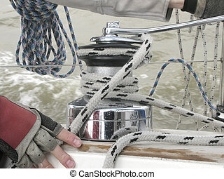 Turning rope on a winch of sailboat