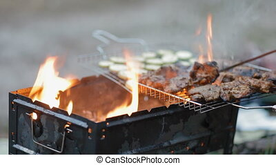 Turning round meat on the grill