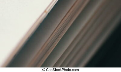 Turning the pages of an old book close-up