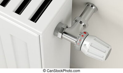 Turning the thermostatic valve on the heating radiator -...