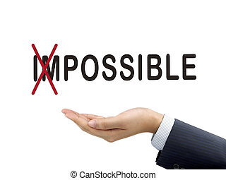turning the word impossible into possible by businessman's hand