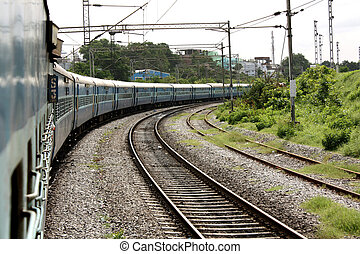 Turning Train - A blue Indian train turning on the tracks.
