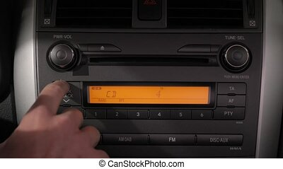 Listening to music CD in a car, turning up the volume for favorite song after changing track