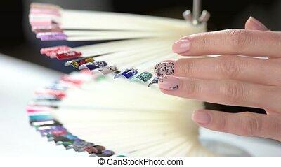 Turning wheel of nail design samples. Nail art fashion...
