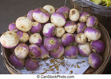 Turnips displayed for sale at a farmers market
