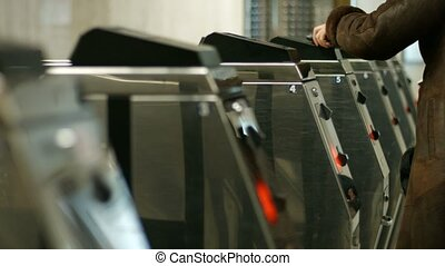 Control of passengers. - Turnstiles in a subway station....