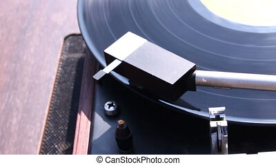 turntable player - Vinyl rotating on a turntable, close up