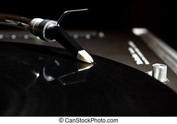 Turntable playing vinyl audio record - Professional analog...