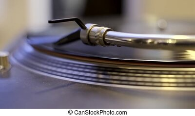 Turntable playing vinyl record macro