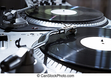Turntable playing vinyl record with music - Professional...