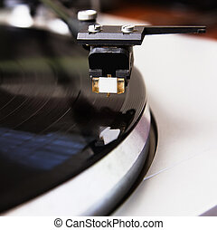 Turntable playing vinyl record with music - Turntable player...