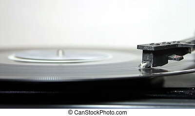 turntable with stylus running a vinyl record - turntable...