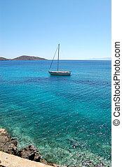 Turquoise Aegean Sea and yacht, Crete, Greece