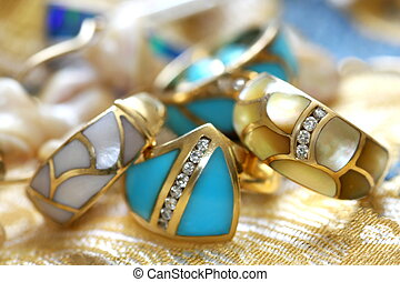 Turquoise and mother of perl rings accented with diamonds -...