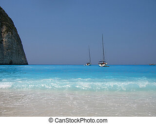 turquoise beach and sail boats