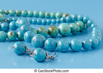 turquoise beads on blue background