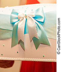 turquoise blue ribbon bow for packaging.