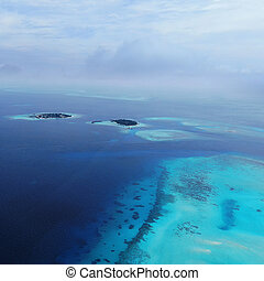 Turquoise blue sea water shore aerial view