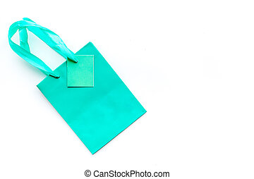 Turquoise bright shopping bag on white background top view copyspace