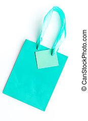 Turquoise bright shopping bag on white background top view mockup