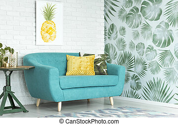 Turquoise couch in sitting room - Yellow pillow on turquoise...