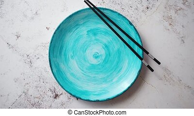 Turquoise hand painted ceramic serving plate with wooden...