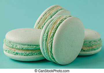 turquoise macaroons on aquamarine background