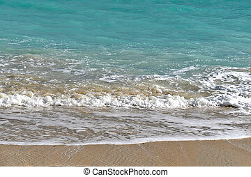turquoise ocean water with frothy surf