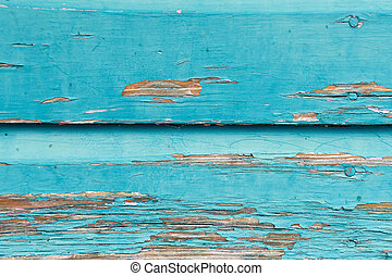 turquoise paint on weathered wood