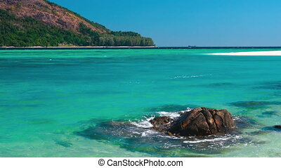 Turquoise sea on exotic paradise island. crystal clear water...