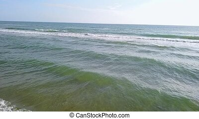 Turquoise sea water waves and sand beach. Aerial survey....