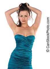 Pretty petite brunette in a turquoise sheath dress