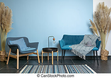 turquoise sofa and chair, classic living room decoration, blue wall, carpet on dark wooden floor, interior style