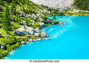 Turquoise Sorapis Lake with Pine Trees and Dolomite Mountains in