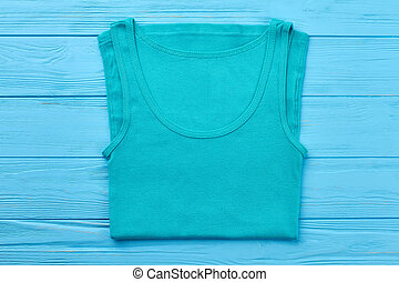 Turquoise t-shirt for sport activity.
