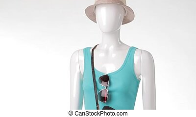 Turquoise tank top on mannequin. Turquoise top with black...