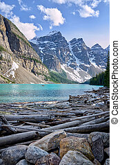 Turquoise waters of beautiful Moraine lake. Snow-covered Rocky mountains in summer day. Banff National Park