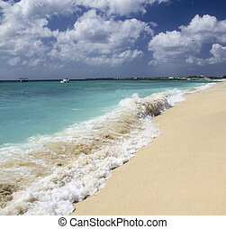 Turquoise Waters of Caribbean Sea with Sky on Background
