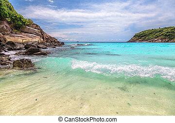 Turquoise waves on the island of Ko Racha Yai. Thai Phuket...