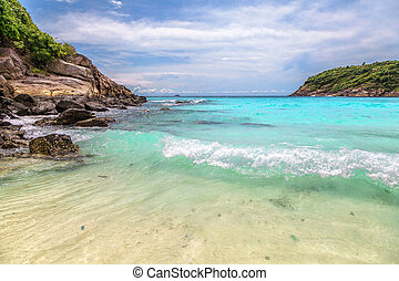 Turquoise waves on the island of Ko Racha Yai. Thai Phuket ...