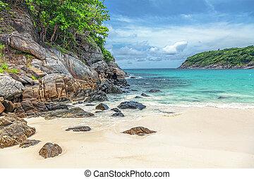 Turquoise waves on the island of Ko Racha Yai. Thai Phuket Province