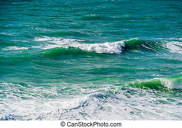 Turquoise waves with foam in the Black sea