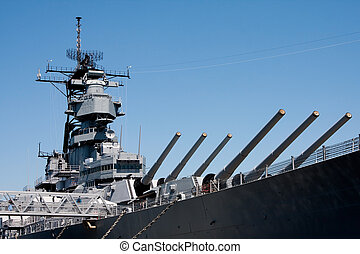 Turret barrels and control tower with radar on a US Navy military Iowa class battleship