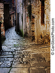 tuscan alley at night - grunge dark alley with staircase at...
