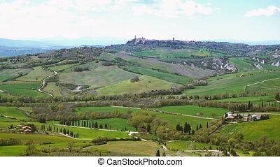 Typical Tuscan landscape with the beautiful green hills -...