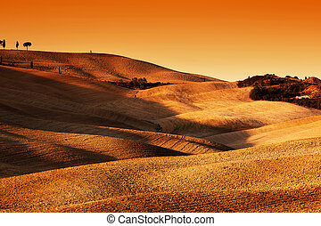Tuscany, Italy landscape at sunset. Picturesque hills with lights and shadows.
