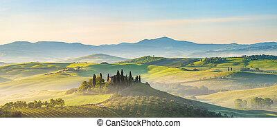 Tuscany landscape at spring foggy morning