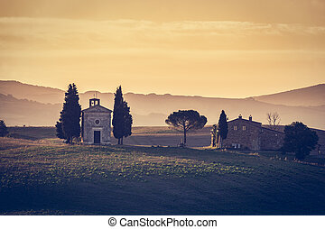 Tuscany landscape at sunrise. Chapel of Madonna di Vitaleta,...